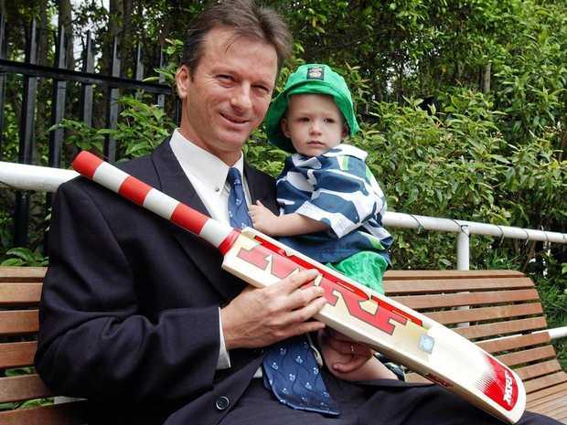 Australian cricket captain Steve Waugh and son Austin in 2001.