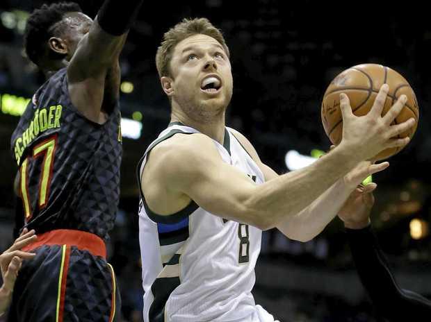 The Milwaukee Bucks' Matthew Dellavedova goes up for a shot.