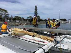 Stricken boat hitches lift with jet ski