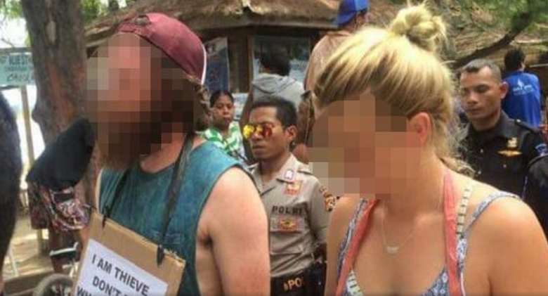 Two Australians were photographed on a 'walk of shame' after being accused of stealing a bicycle on the Indonesian island of Gili Trawangan. Picture: Facebook/Gili Trawangan, Meno, Air