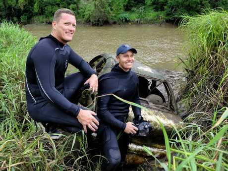 Police divers Craig Boles and Jimmy Hall helped recover a Mazda 121 from the Bremer River in Basin Pocket on Thursday.