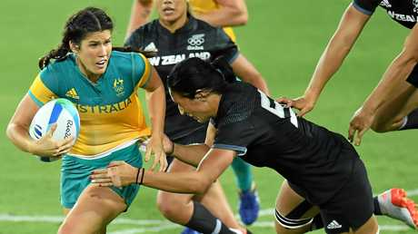 Australia's Charlotte Caslick is tackled by Sarah Goss of New Zealand in the Women's Rugby Sevens at the Rio 2016 Olympic Games.