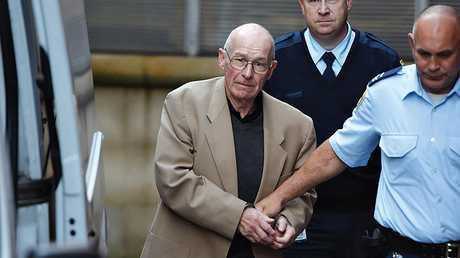 Former Detective Roger Rogerson being led to a prison van at Sydney Supreme Court in June.