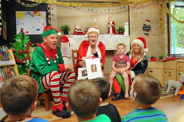 ALL FOR THE KIDS: Mrs Claus Coffs Coast aka Margaret Schumacher, with her elves Happy and Pixie from The Smiley's at Banksia Preschool this week.