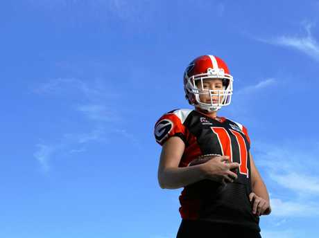 Ipswich gridiron player Meagan Cover has been invited to try out at the Australian women's gridiron camp.