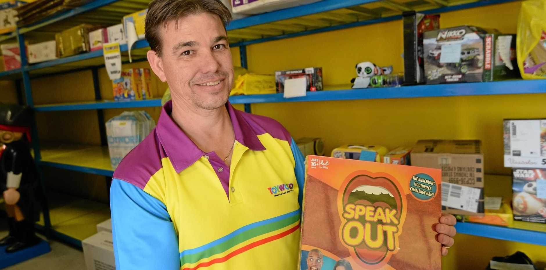 HOT ITEM: Dennis Boyce from Toyworld with the last Speak Out game before a final shipment arrives at the Rockhampton store.