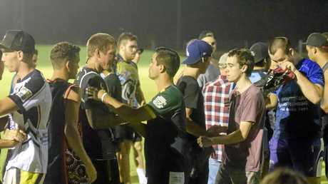 Players and trainers from Lower Clarence Magpies shake hands after they announced they would drop out of first grade this season.