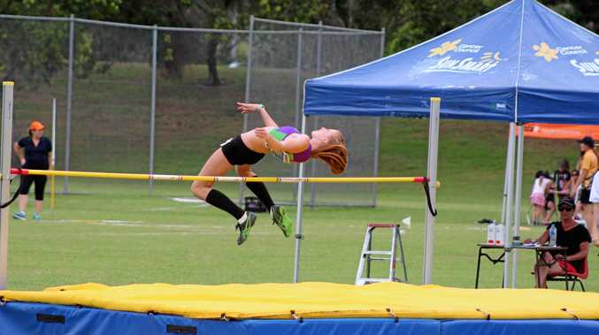 GOING FOR GOLD: Grafton Little Athletics competitor Erica Tillman easily clears the bar on her way to high jump Zone record.