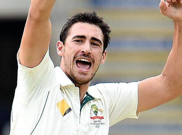 Australian bowler Mitchell Starc celebrates taking the wicket of Pakistan's Azhar Ali at the Gabba.
