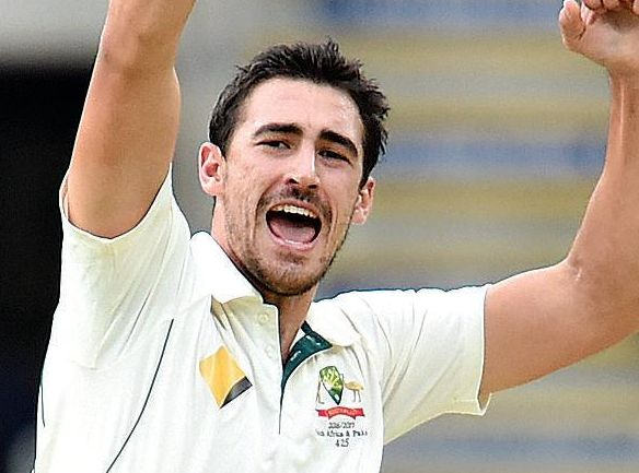 Australian bowler Mitchell Starc celebrates taking the wicket of Pakistan's Azhar Ali at the Gabba.