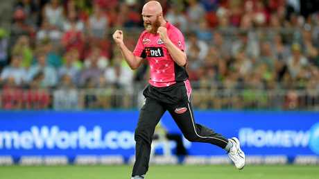 Doug Bollinger of the Sixers celebrates a wicket.