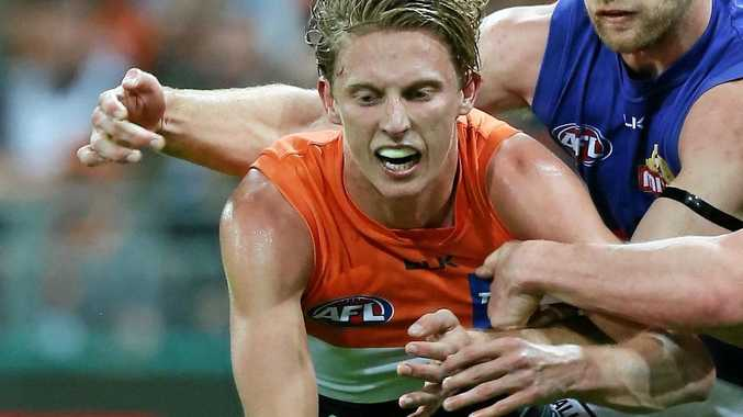 Lachie Whitfield of the Giants is tackled during the AFL preliminary final against and the Bulldogs.