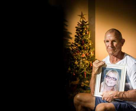 Tony Marshall holds a picture of his daughter Alissa, who was killed in a collision on Yamba Road in 2012.