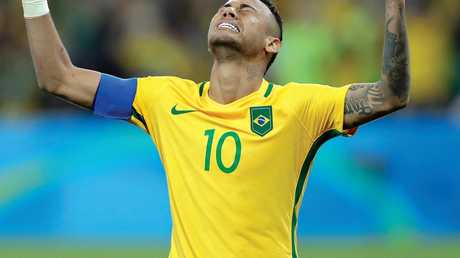 Brazil's Neymar celebrates after scoring the decisive penalty kick during the final match of the men's Olympic football tournament.