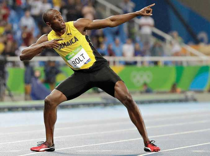 Usain Bolt, from Jamaica, celebrates winning the gold medal in the men's 200m final at the Rio Olympics.