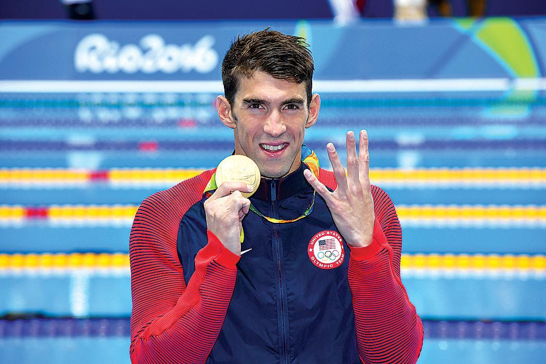 Michael Phelps of the United States poses for a photograph after winning the Men's 200m Individual Medley final, at the Olympic Aquatics Stadium on day six of the Rio 2016 Olympic Games in Brazil, Thursday, Aug. 11, 2016. (AAP Image/Dean Lewins) NO ARCHIVING, EDITORIAL USE ONLY