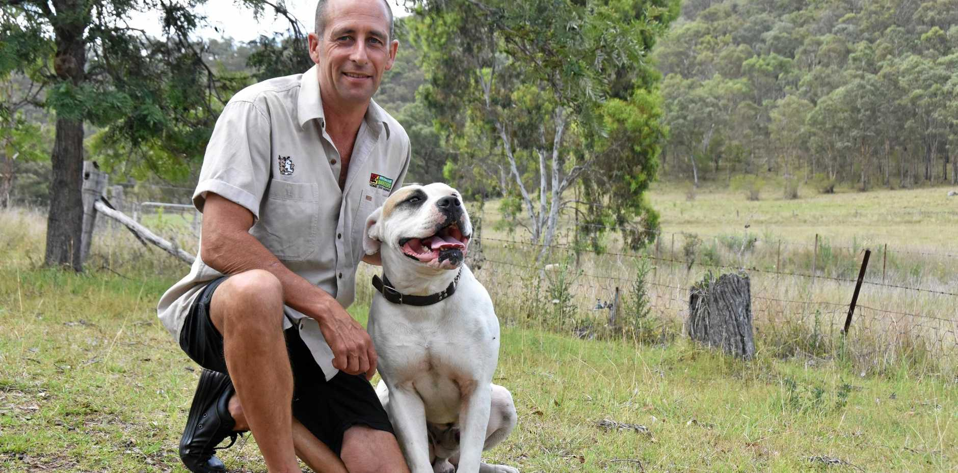 GOOD BOY: Neil Erskine is a dog trainer who talks about the importance of giving your dog an easy to understand name. He's pictured with Bullseye.