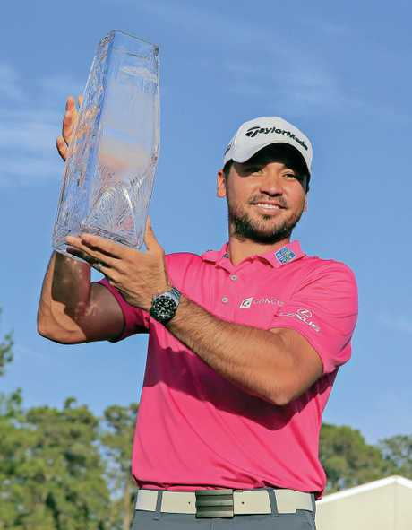 Jason Day of Australia holds the trophy after winning the Players Championship.