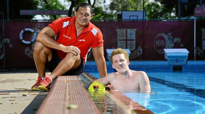 Ipswich Grammar School swimming coach Greg Fasala with IGS swimmer and PNG representative Ryan Maskelyne.