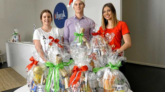 TIME TO GIVE: iThink Property's property manager Cassie Ballin and sales team members Dan O'Reilly and Jess McPherson have prepared Christmas hampers.