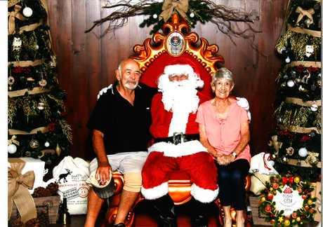 Dennis and Rosalie Halcrow with Santa.