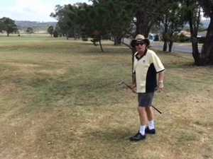 Bruce Williams hits off at golf