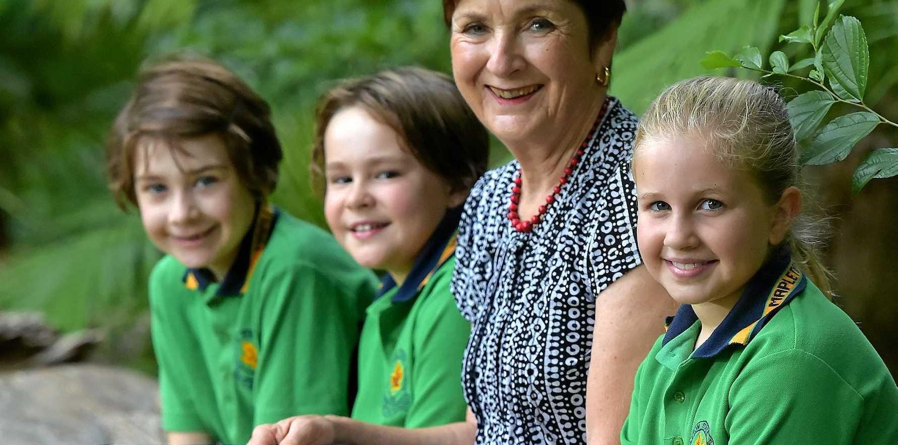 Mapleton State School principal Jen Clarke with Year 3 students Elizabeth, Ellen and Laura.