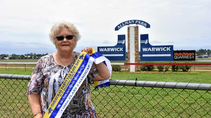 ALWAYS REMEMBERED: Pam Hockings with last year's memorial race day sash held for her late husband Hector Hockings. The second annual memorial race is on Boxing Day.