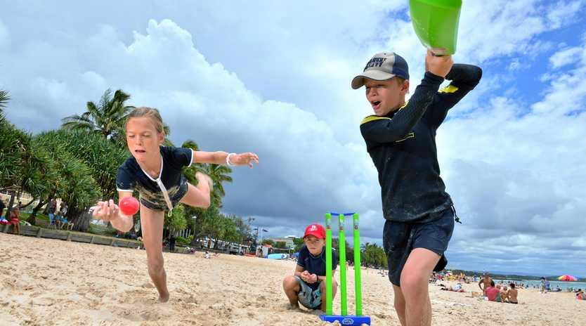 Molly Stoddart, 11, Joe Stoddart, 9, and Hugh Rylance, 9, of Brisbane get stuck into some beach cricket on Main Beach, Noosa Heads.