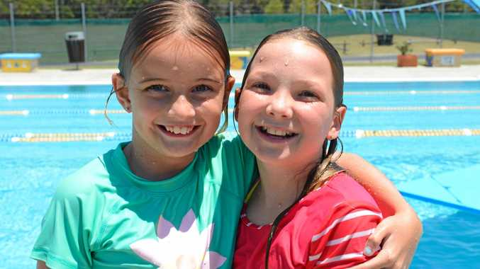 Pippa Townsend (left) and Hannah Smith both of Queensland are cooling off at the Yamba Community Pool on Saturday, 24th December, 2016.