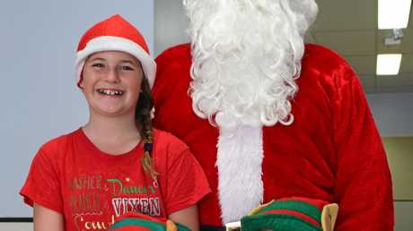 Santa at the Warwick Hospital with his little helpers.