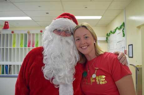 Santa says g'day to Warwick Hospital nurse Sally Whitton.