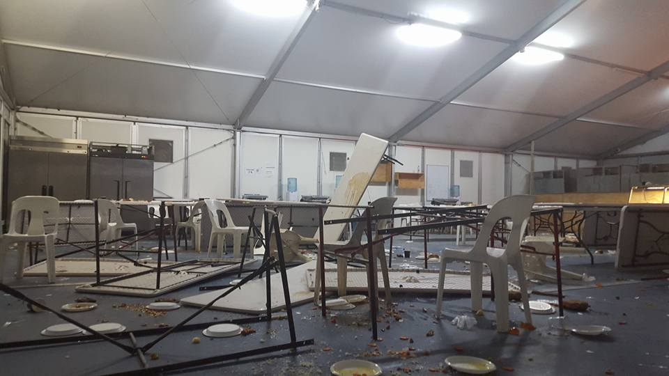Behrouz Boochani shared this image on Facebook of upturned tables in the Manus Island detention centre on Christmas Eve.