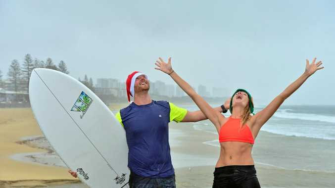 BABY IT'S STORMING OUTSIDE: Tom McLean and Jacqueline Petersen don't mind the wet weather.