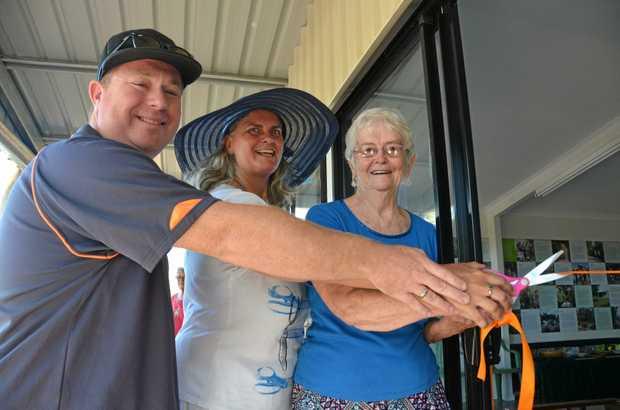 GRAND OPENING: Kevin Trustum, Lismore City Councillor Vanessa Ekins and Marie Matthews open the new Lismore Rainforest Botanic Gardens Visitor Centre.