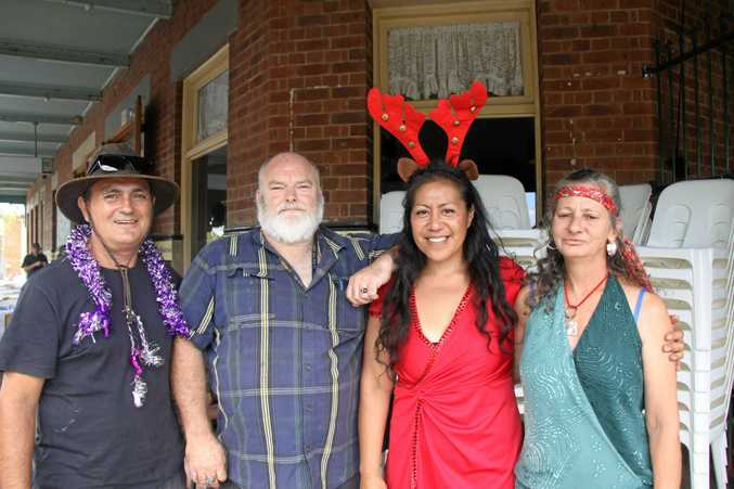 Turhan Dervish, Dave Blackney, Sepulona Ireland and Roni, get into the festive spirit at The Winsome Soup Kitchen's Christmas Lunch.