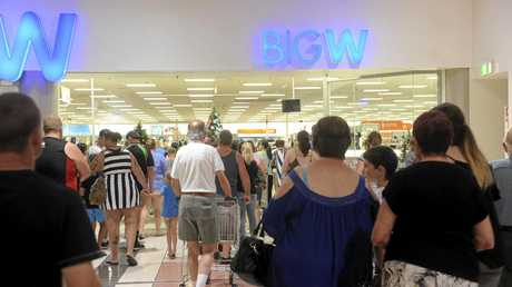 People rush into Big W at Grafton Shoppingworld as the Boxing Day Sales begin.