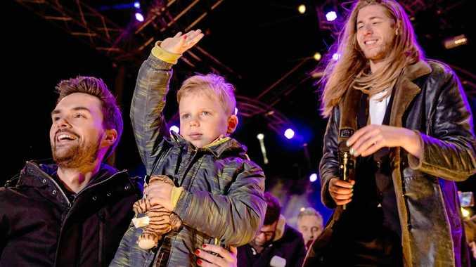 Dutch DJs Domien Verschuuren and Frank van der Lende together with six-year-old Tijn Kolsteren.