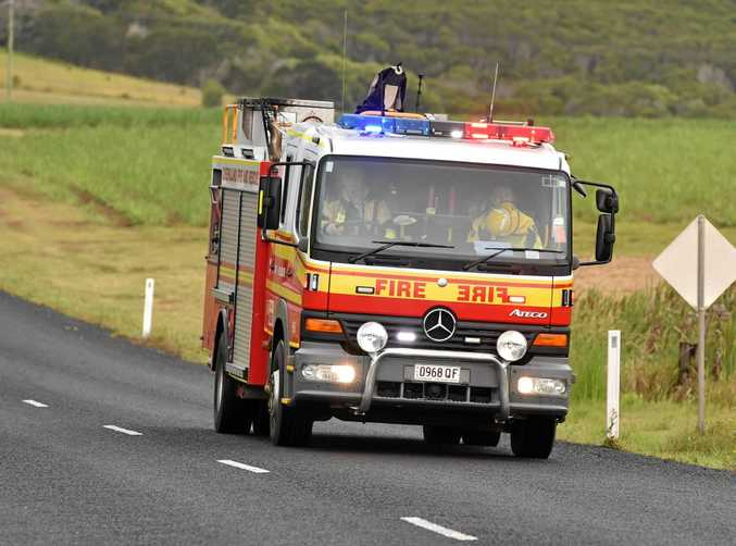 Queensland Fire and Emergency Service are trying to free a child trapped in a septic tank at Campwin Beach.