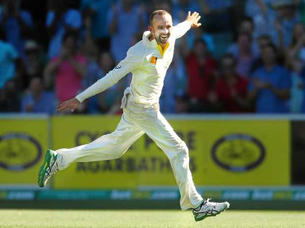 SO NICE: Australian spinner Nathan Lyon made an immediate impression when he took the wicket of Sami Aslam with his third ball of the day.