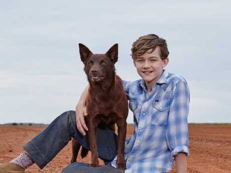 Levi Miller with Phoenix, the dog, in Red Dog: True Blue.