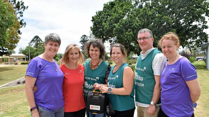 GIFT OF LIFE: Annie Bradford and Kym O'Leary (centre) present a defibrillator to the parkrun Warwick crew, Tara Behrmann, Karen Welsh, Justin Nolan and Rae Lewis.