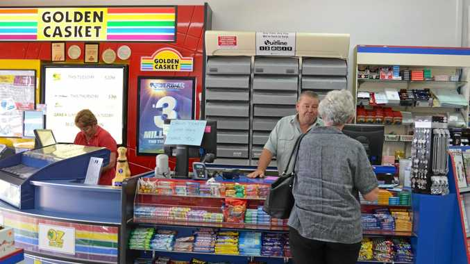 Peter Hynes serves one of his loyal customers at Hynes Newsagency.