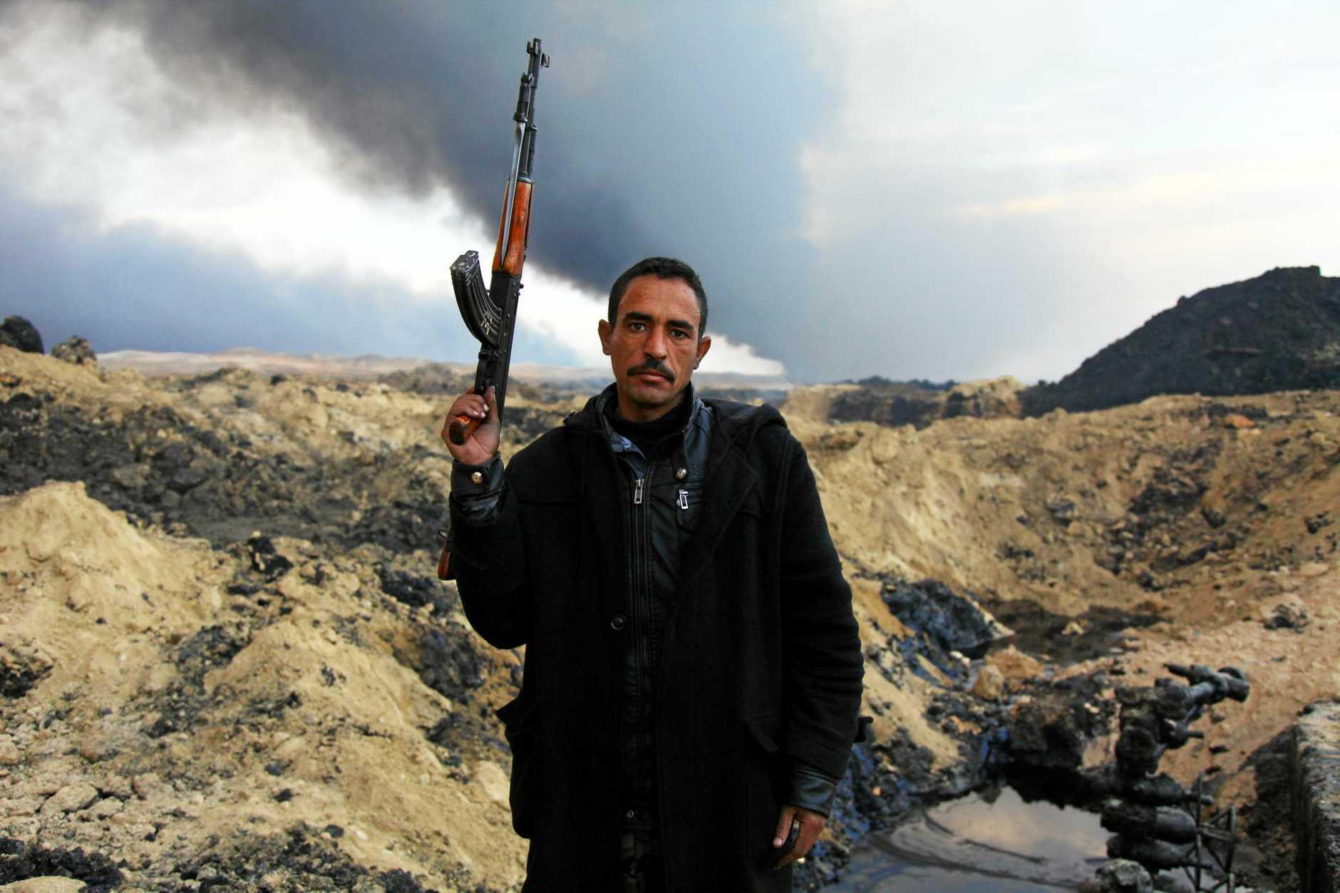 RARE INSIGHT: Local police extinguish oil pits in Al - Qayyara.