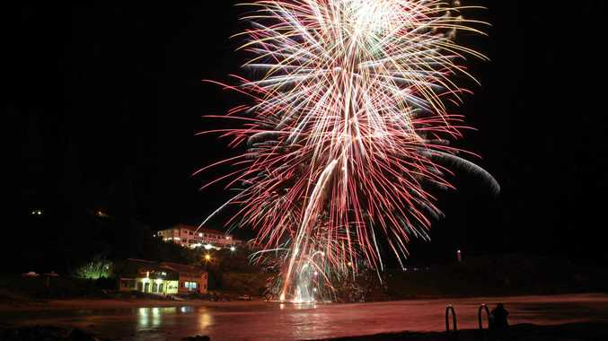 Fireworks lit the sky above Yambas Main Beach at midnight on New Years Eve, to signal the start of 2012. Photo: Lynne Mowbray/The Daily Examiner