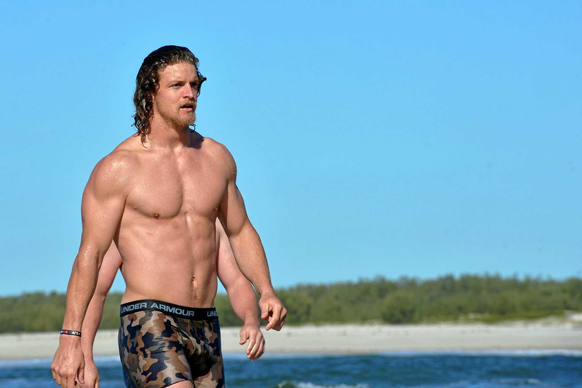 The Wallabies take a swim at Caloundra. Nick Cummins, The Honey Badger.   Photo: John McCutcheon / Sunshine Coast Daily