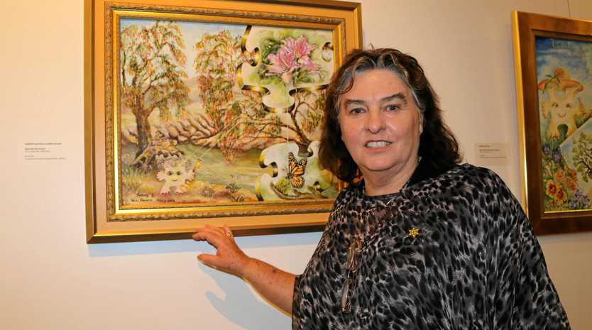 ON SHOW: Sharon Davson unveiled her latest exhibition called Davson - Creation at the Lockyer Valley Art Gallery. She is pictured with the piece titled 'Naturally Harmonious' which combines both Sharon and Win Davson's talents.