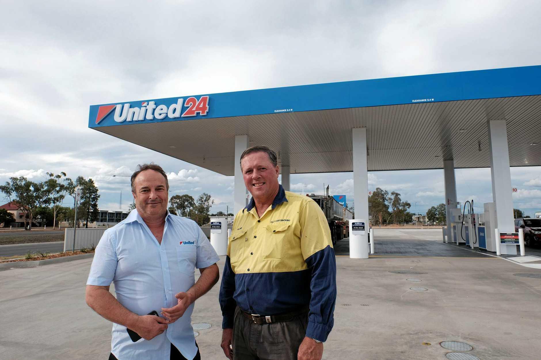 IN BUSINESS: United Petroleum food merchandiser Brian Glassel with Miles developer Glenn Tilly.