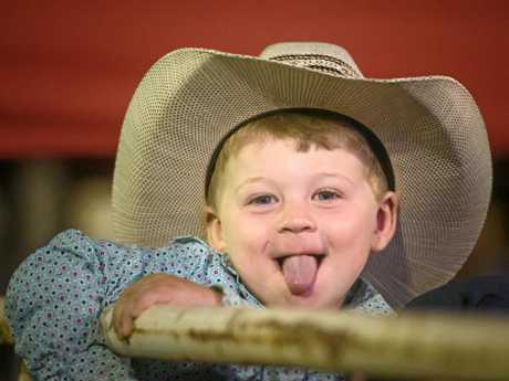 Noah Love, 3 gives a cheeky smile at Maclean Twilight Rodeo