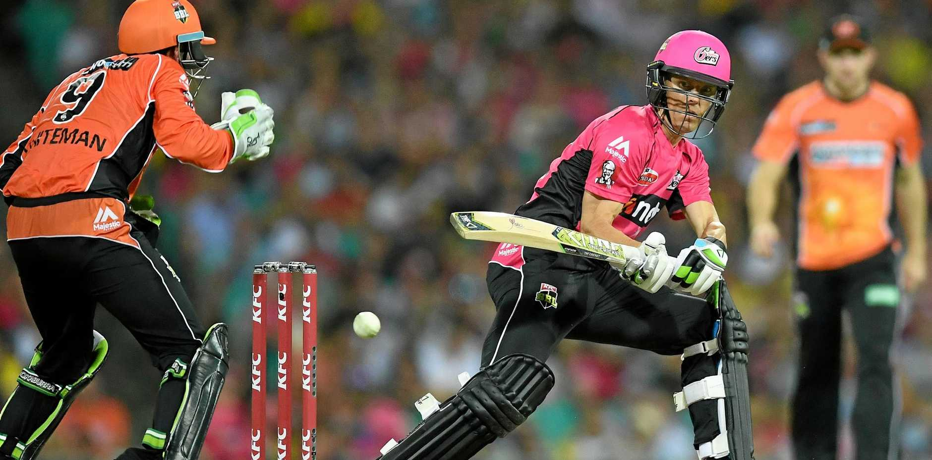 Johan Botha of the Sixers plays a reverse sweep shot against the Scorchers.